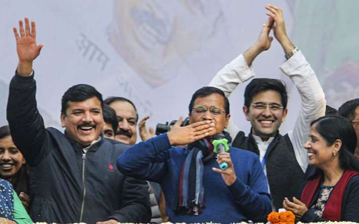Delhi CM and AAP convenor Arvind Kejriwal (C) gestures during his address to supporters after party