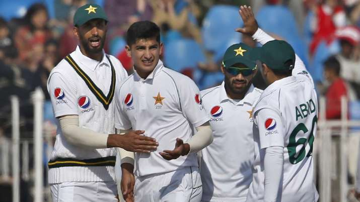 Pakistan pacer Naseem Shah, center, celebrates with
