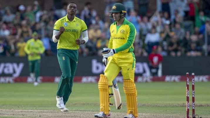 South Africa's bowler Lungi Ngidi, left, celebrates after