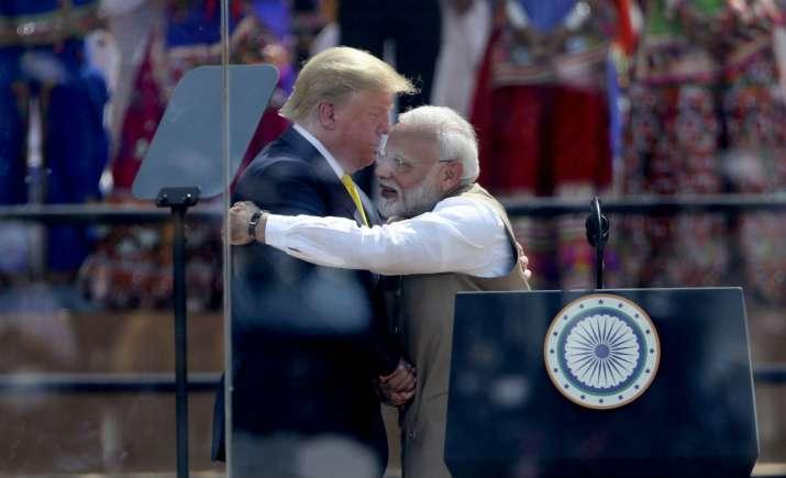 India Tv - US President Donald Trump and Indian Prime Minister Narendra Modi hug at Sardar Patel Stadium in Ahmedabad