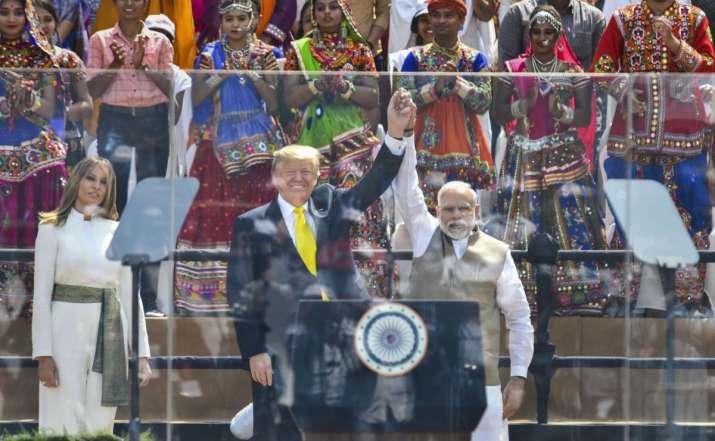 India Tv - US President Donald Trump as First Lady Melania Trump looks on during the 'Namaste Trump' event at Sardar Patel Stadium in Ahmedabad