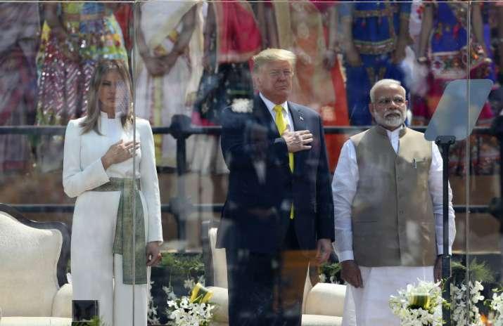 India Tv - US President Donald Trump, Melania Trump and Indian Prime Minister Narendra Modi stand for American national anthem at Sardar Patel Stadium in Ahmedabad