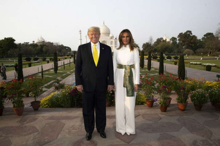 India Tv - US President Donald Trump, with first lady Melania Trump, pause as they tour the Taj Mahal