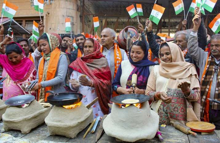 Women Shiv Sena members make 'chapatis' on clay chulhas (ovens) during a unique protest against the