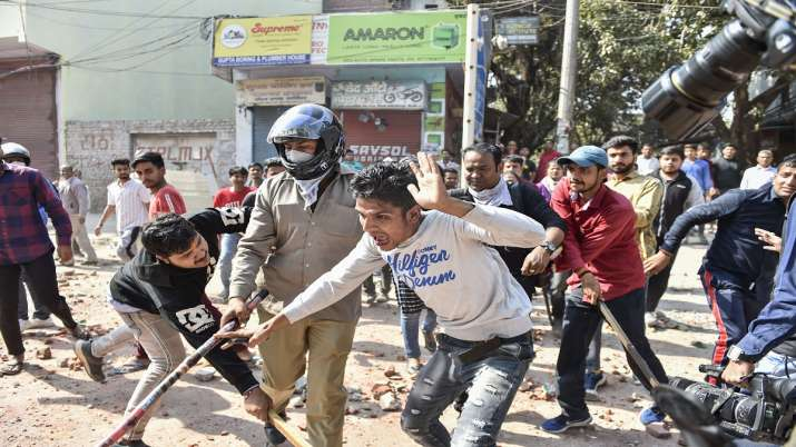 India Tv - Protestors during clashes between a group of anti-CAA protestors and supporters of the new citizenship act, at Jafrabad in north-east Delhi