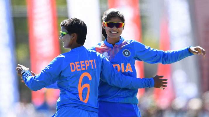 Radha Yadav of India is congratulated by team mates after