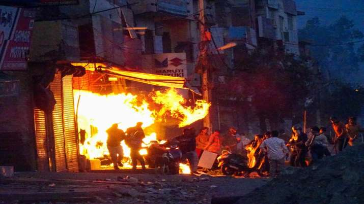 India Tv - Rioters set ablaze a shop during clashes between those against and those supporting the Citizenship (Amendment) Act in at Gokalpuri in north east Delhi