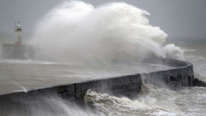 Waves crash into the wall at Newhaven south east England,