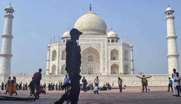 India Tv - Security personnel patrol the premises of Taj Mahal ahead of US President Donald Trump's visit, in A