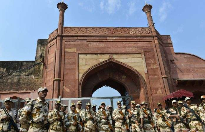 India Tv - Security Forces stand guard at the gate of Taj Mahal ahead of US President Donald Trump's maiden vis