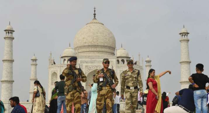 India Tv - Central Industrial Security Force personnel patrol in the premises of Taj Mahal ahead of US Presiden