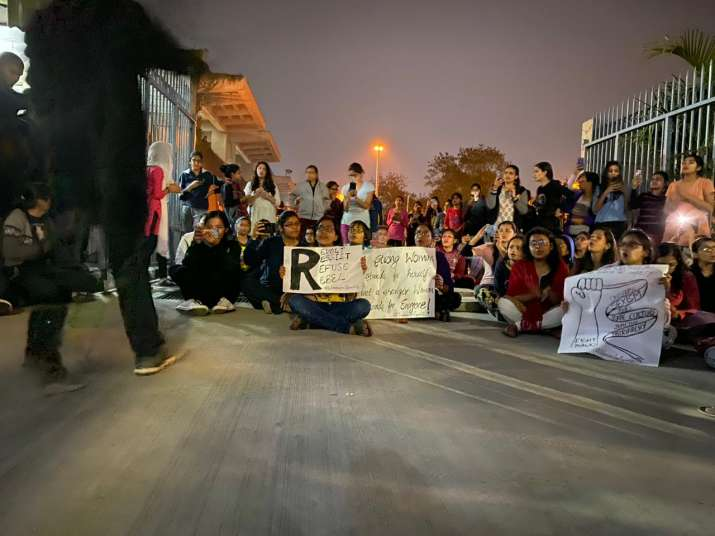 Students protesting against the imposition of curfew on
