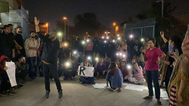 India Tv - Students protesting against the imposition of curfew on female students of Delhi University Hostel