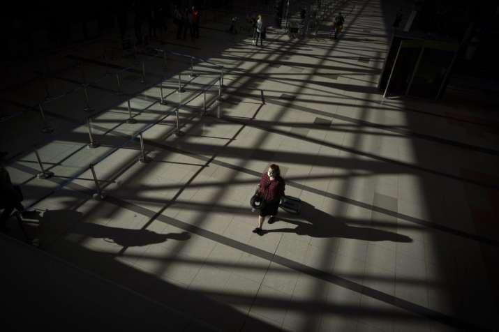 A passenger walks through an empty terminal at Ezeiza International Airport in Buenos Aires, Argenti