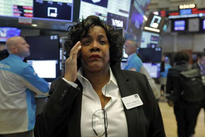 Yvette Arrington, with the New York Stock Exchange Trading Floor Operations, works on the floor of t