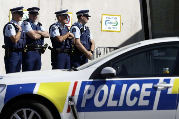 Police keep watch outside Friday prayers at an arena in Christchurch, New Zealand, Friday, March 13,