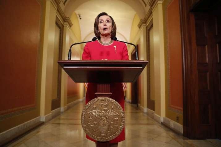 House Speaker Nancy Pelosi of Calif. speaks outside her office on Capitol Hill, Monday, March 23, 20
