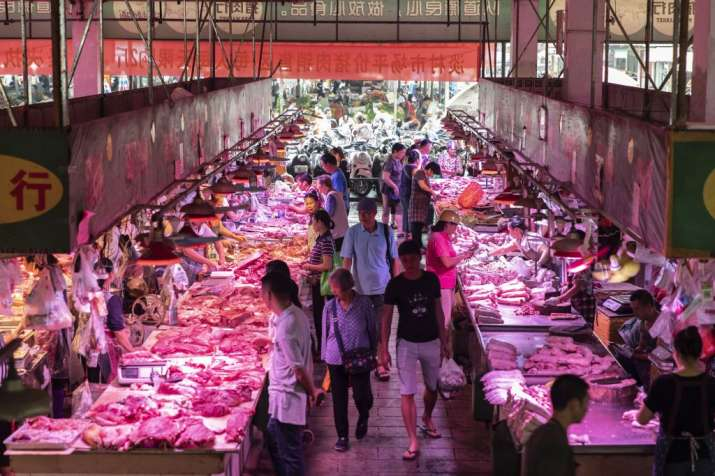 India Tv - A traditional Chinese wet market regularly sells an array of foods and meats. Pictured is a market i