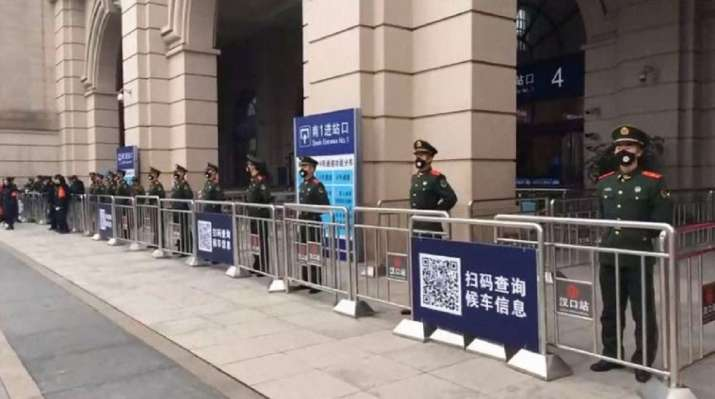 Chinese paramilitary police stand guard outside the closed