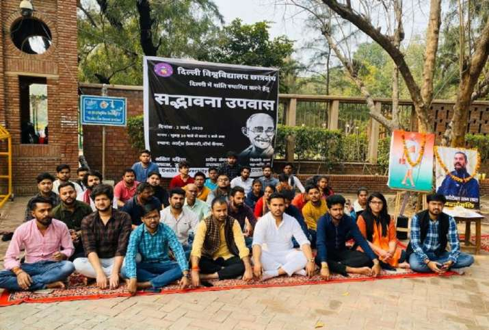 DUSU members sitting on a fast to demand the restoration of