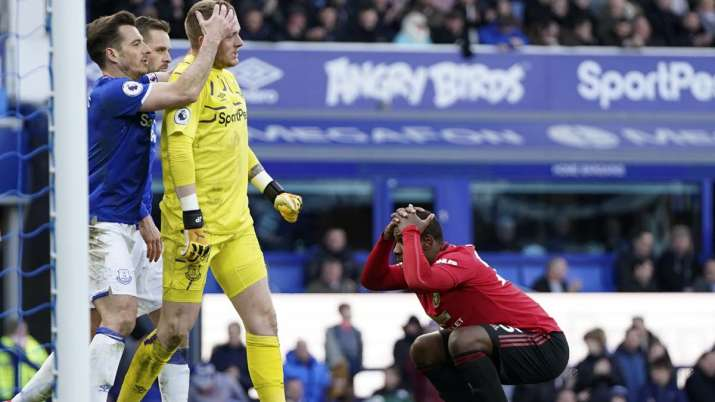 Manchester United's Odion Ighalo, right, reacts after