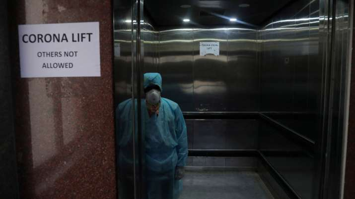India Tv - A lift operator inside an elevator dedicated for people suspected to be infected with the novel coro