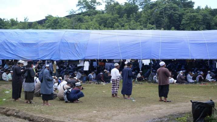 India Tv - Pilgrims pray on a field where a mass congregation is supposed to be held in Gowa, South Sulawesi, I