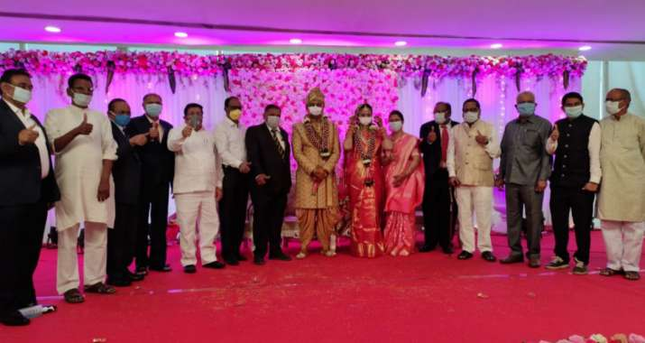 Couple ties knot with masks on; hand sanitisers, packaged food for guests