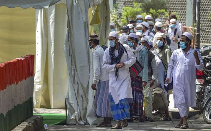 India Tv - New Delhi: People who attended Tabligh-e-Jamaat congregation in Nizamuddin West board walk to board a bus for the LNJP Hospital for screening and COVID-19 test, in New Delhi, Tuesday, March 31, 2020.
