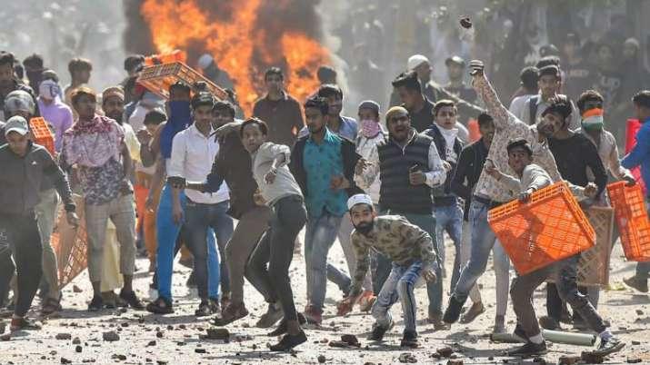 Delhi violence 1 arrested for killing anil sweet house 39 s for Mohd shop