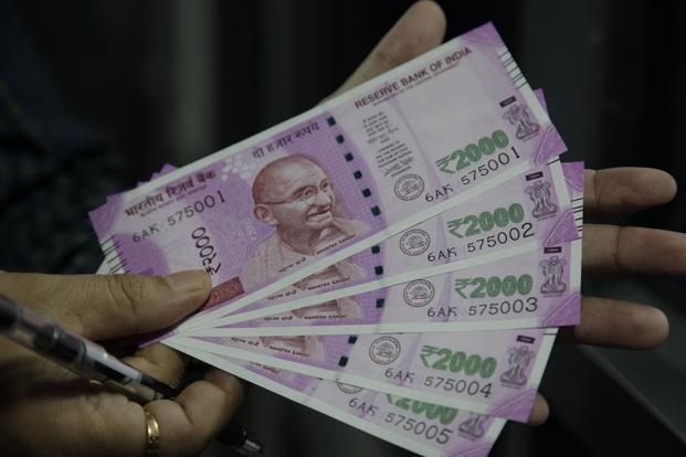 Rupee sinks below 74/USD level in early trade amid mounting fears of coronavirus-led slowdown