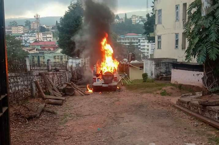 File photo of a vehicle set on fire by protesters agitating against the passing of Citizenship Amend