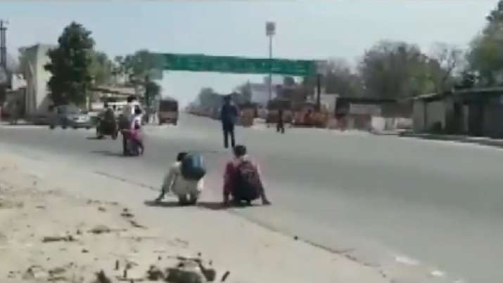 Police make lockdown violators crawl with their bags in