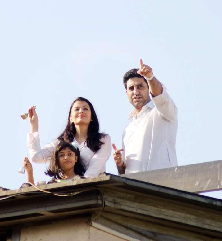India Tv - Aishwarya, Abhishek and daughter Aaradhya at the balcony cheering.