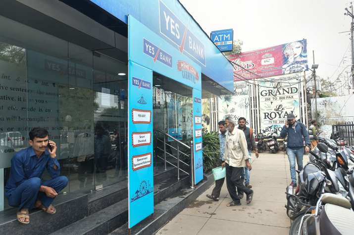 Account holders arrive at Yes Bank branch, in