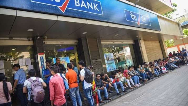 A file photo of people queueing at a Yes Bank branch