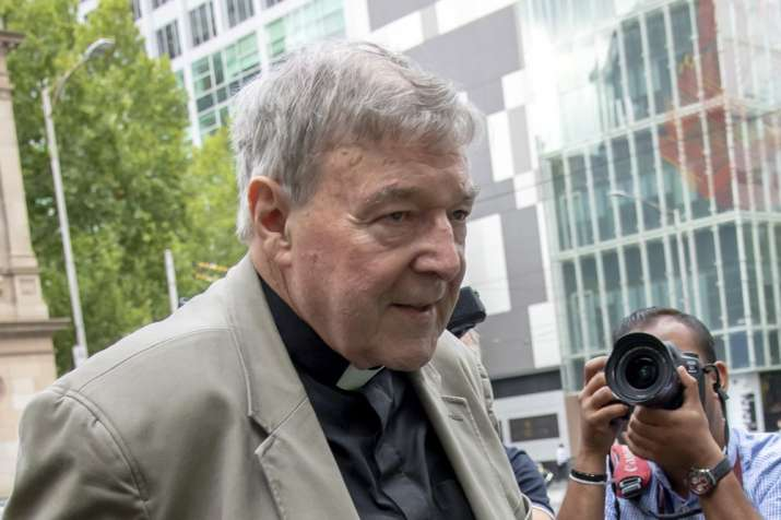In this Feb. 26, 2019, photo, Cardinal George Pell leaves the County Court in Melbourne, Australia.