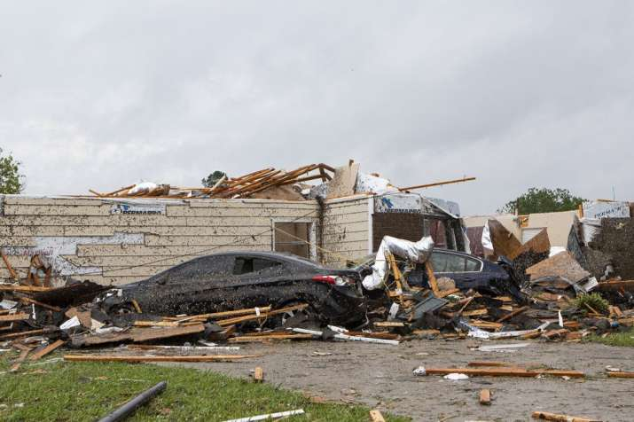 A home had its roof torn off after a tornado ripped through Monroe, La. just before noon on Sunday,