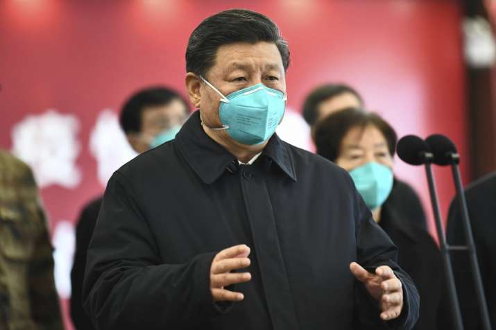 In this Tuesday, March 10, 2020, photo released by China's Xinhua News Agency, Chinese President Xi