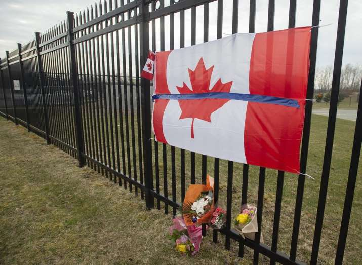 A tribute is displayed Monday, April 20, 2020, at the Royal Canadian Mounted Police headquarters in