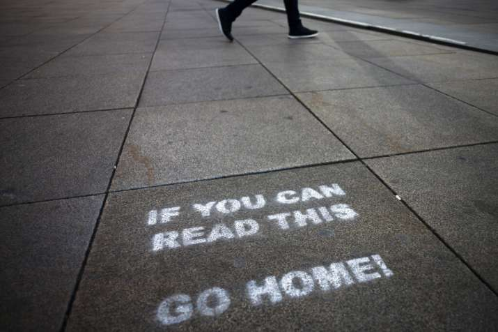 A message demanding the people to go home is sprayed on the ground of Alexanderplatz square in Berli