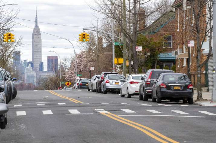 The Empire State building is seen in the distance from an empty street, Thursday, April 2, 2020, in