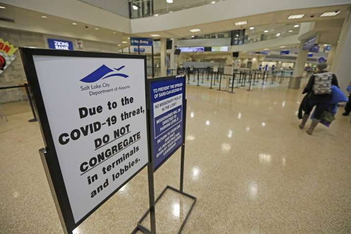 A COVID-19 sign is shown at Salt Lake City International Airport Tuesday, April 7, 2020, in Salt Lak