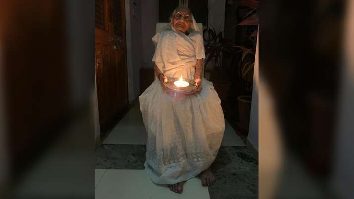 9 pm, 9 minutes: PM Modi's mother Heeraben lights a lamp