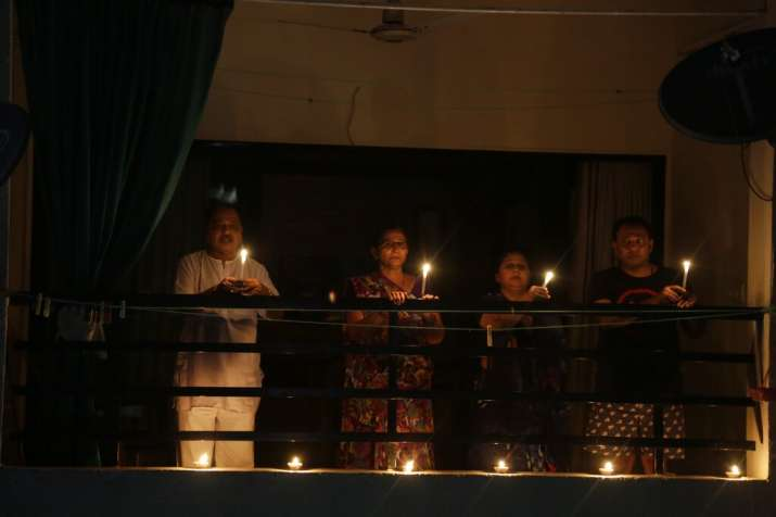 India Tv - A family in Ahmedabad on their balcony