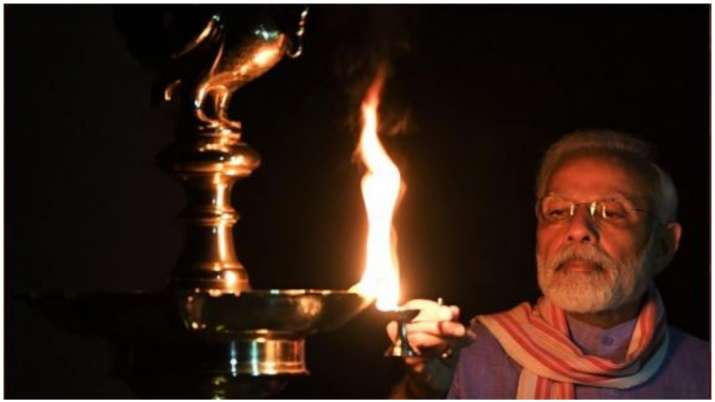 Prime Minister Narendra Modi lighting a diya at his