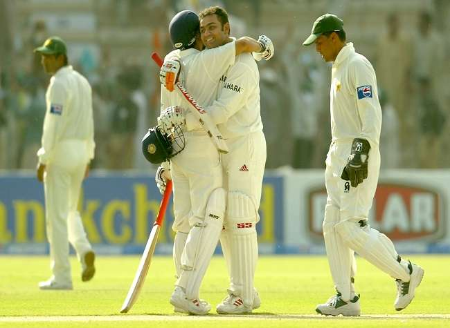 India Tv - Virender Sehwag is hugged by Sachin Tendulkar of India after Sehwag reached his 200 during day one of the 1st Test Match between Pakistan and India at Multan Stadium on March 28, 2004 in Multan, Pakistan.