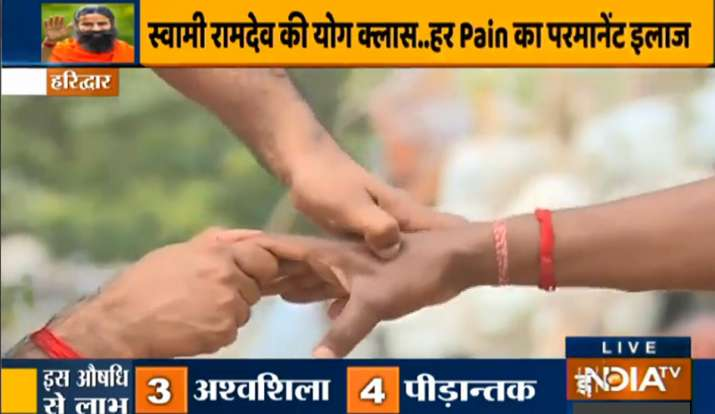 India Tv - Treat cervical spondylosis with acupressure suggested by Swami Ramdev