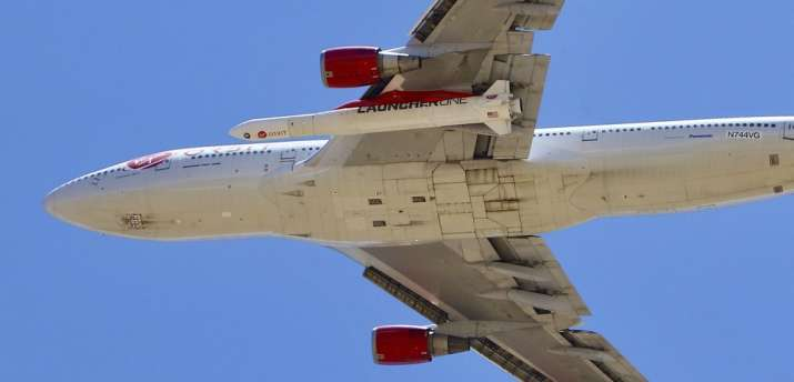 A Virgin Orbit Boeing 747-400 aircraft named Cosmic Girl takes off from Mojave Air and Space Port in