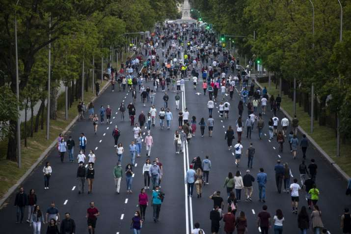 People exercise along Paseo de la Castellana after the lockdown measures imposed by the government